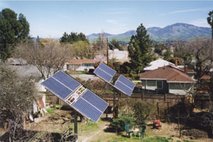 English: Rooftop view of backyard solar tracke...